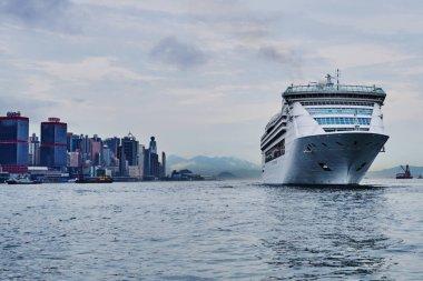 Large cruise ship entering Victoria Harbour, Hong Kong.