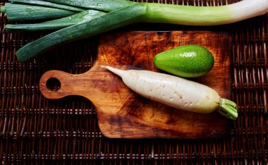 Horseradish and avocado on the vintage table, creative picture of fresh veggies