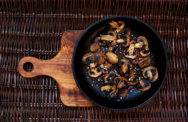 Fresh mushrooms collected in the forest fried in a deep frying pan,mushroom protein source,space for text