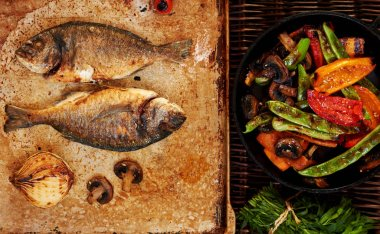 Cook two small fish gilt-head bream  baked in the oven until crisp hipster filter color