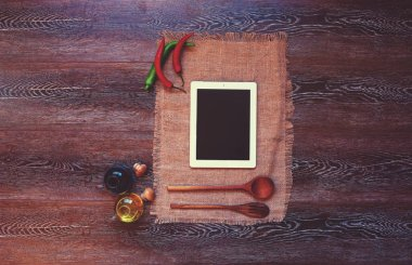 On the kitchen linen towel housewife left her plate, which looked new recipe sauce for the fish of the hot pepper oil and soy sauce