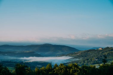 Beautiful foggy landscape in Tuscany, Italy.