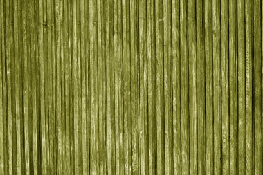 Decorative wooden surface in yellow color.