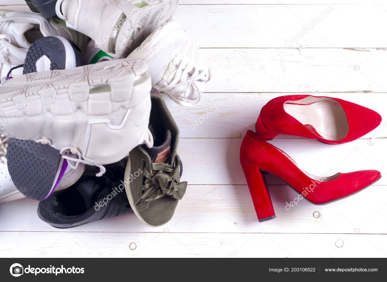 9be9194cf096 Big heap of different sports shoes and red high heel womens shoes on white  background. Set of sneakers — Photo by ...