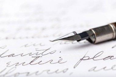 Fountain pen on antique handwritten letters
