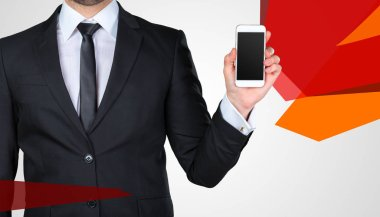 Unrecognizable businessman showing blank smartphone screen with copy space