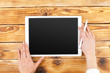 Woman Using Digital Tablet on background,close up