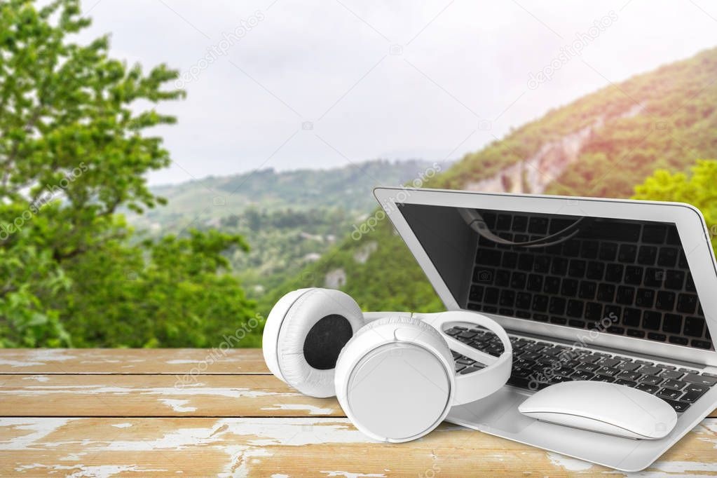Headphones with laptop on table