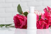 Fotografie Perfume bottles with flowers