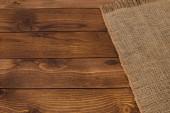 Fotografia Sfondo con tavola di legno vuota e tovaglia