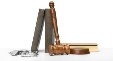 wooden gavel and handcuffs on table