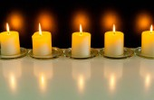 closeup view of burning candles in darkness