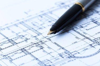 Pen and architectural blueprints