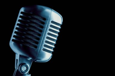 vintage microphone over black, close-up view