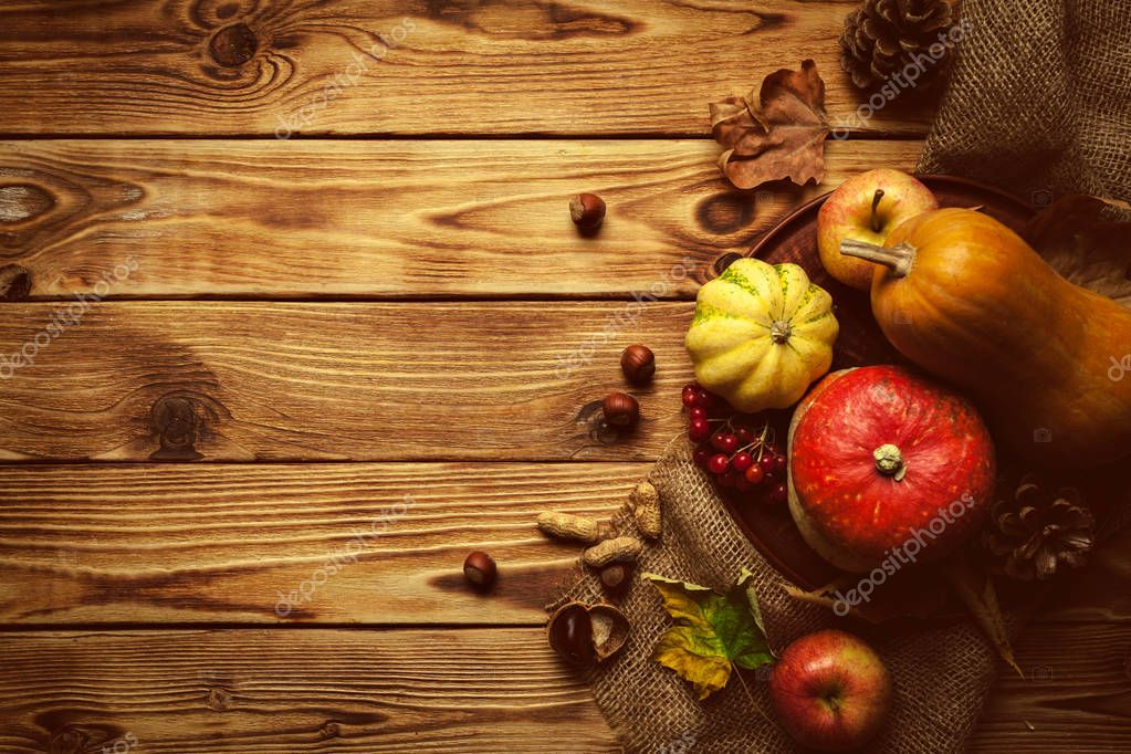 Autumn wooden background with copy space