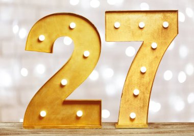 Big plastic numbers with shining light bulbs, close-up view