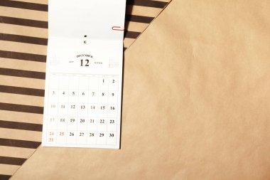 December calendar page on a desk