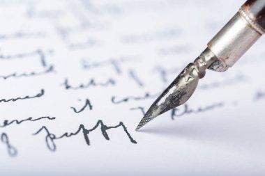 Fountain pen on antique handwritten letter