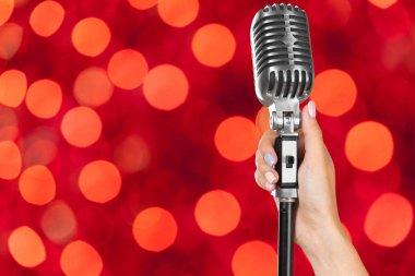 Popular singer holding vintage microphone
