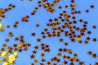 Golden stars confetti, close up