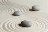 zen meditation stones on sandy background