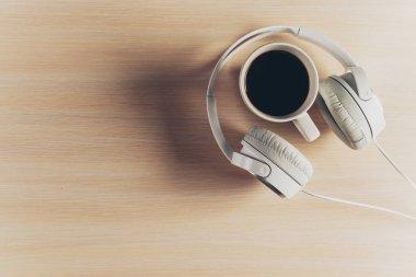 Headphones on wooden desk table.