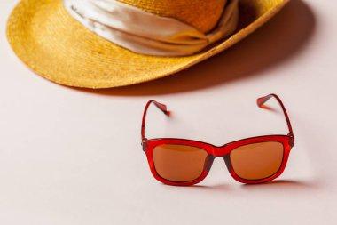 Stylish summer hat and sunglasses, close up