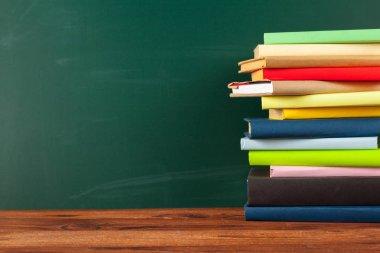 Books on Desk, Chalkboard Background stock vector