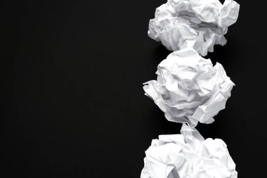 ball of crumpled white paper on background