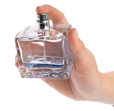 Woman hand with perfume bottle isolated on white background