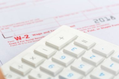 close-up of tax forms, business accessories