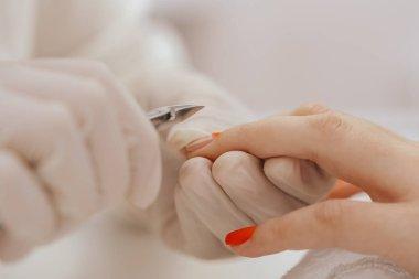 close up of Manicurist doing manicure