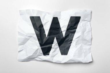 Grunge wrinkled paper letter W on white background
