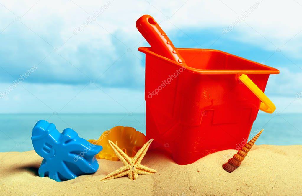 Plastic children toys on sand beach