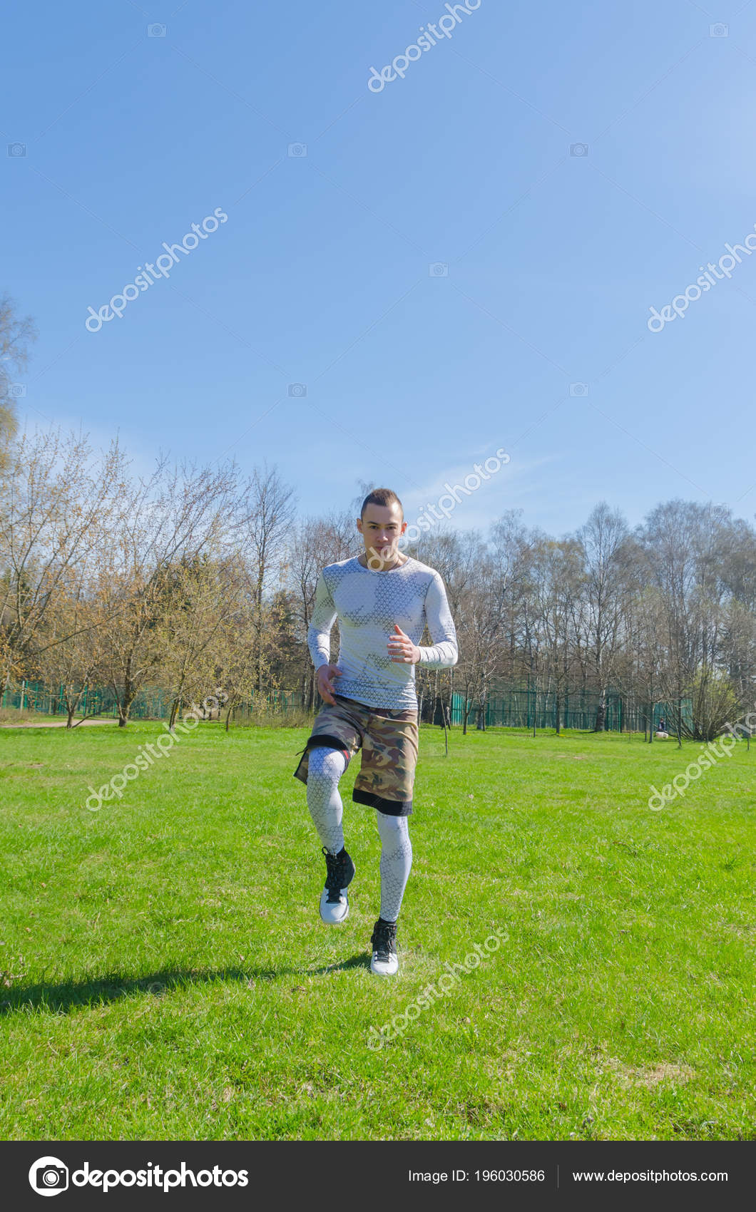 ce7d0522519 Strong Man White Sports Clothes Summer Training Park — Stock Photo ...