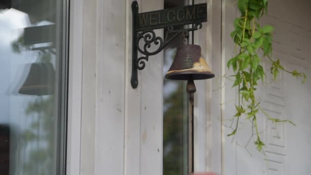 the bell with a rope rings at the door