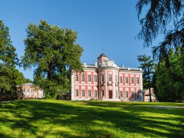 MOSCOW, RUSSIA - August 20, 2015. Bolshie Vyazyomy Manor, estate of princes Golitsyn. Main building in the center of park. Moscow region, Russia. Now it is Historical museum of poet A.S. Pushkin