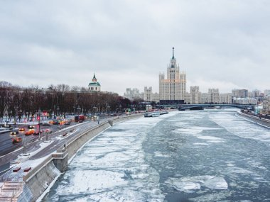 Winter cityscape with Moscow-river and famous Stalin's skyscraper on Kotelnicheskaya embankment. Russia.