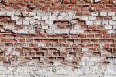 Stará červená bílá cihlová zeď jako pozadí, textury
