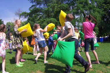 Moscow, Russia - June 01, 2013: Children taking part in pillow fight on Children Protection Day in the park Gorkogo in Moscow