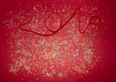Photo number 2019 of red rope on red background with colorful confetti. Christmas theme.