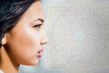 Portrait of asian  girl in profile on Arabic ligature background, model woman is a asian beauty