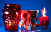Photo human skulls, Halloween orange candles