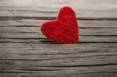 happy valentines day.  red heart shape  in crack of wooden board texture