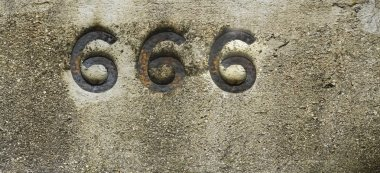 number 666 on stone background. iron number