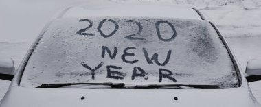 winter inscription 2020 New Year background, text on snow surface. merry christmas, happy new year.