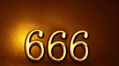 house number six hundred and sixty six (666) embossed in a metal plate.  The number of the beast.  Number of devil, satan on door background