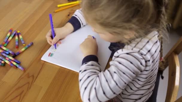 Preschooler draws flags