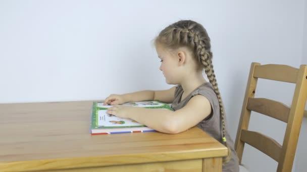 Preschool girl learning to read