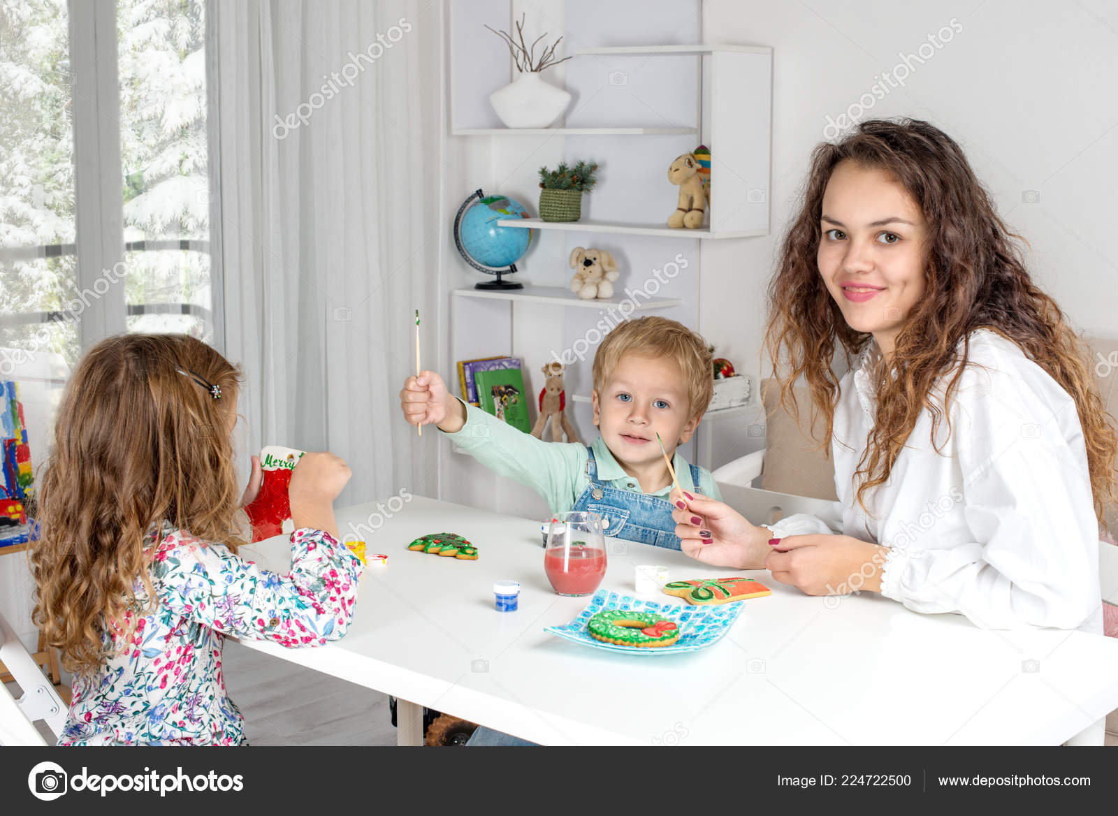 A Nanny For Christmas.Little Children Nanny Young Mother Teacher Prepare Christmas